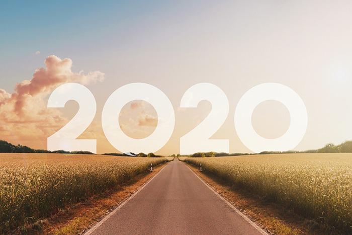 empty, straight road heading towards new year 2020 - happy new year concept,
