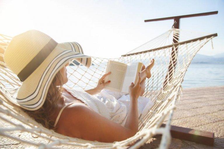 woman in hammock reading a book