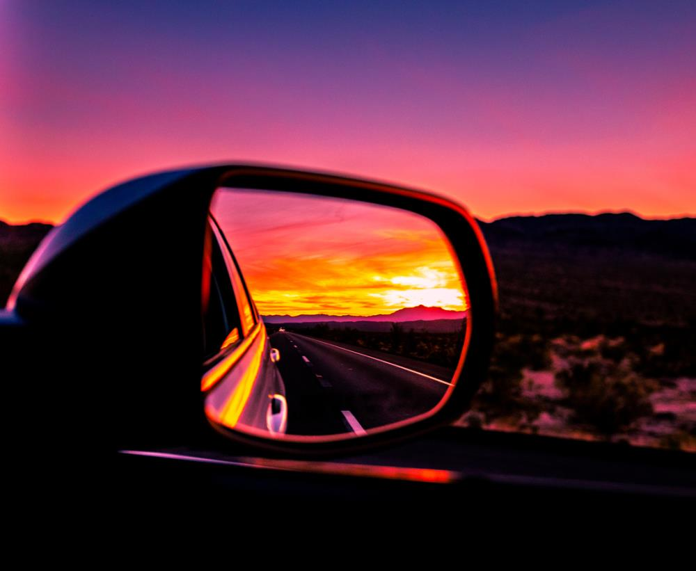 car side mirror with sunset in reflection
