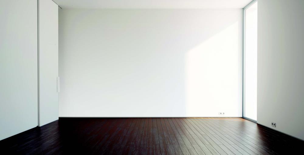 empty room white walls dark wood floor