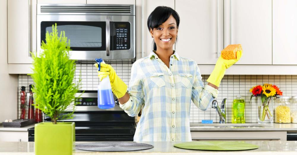 woman in kitchen with rubber gloves on