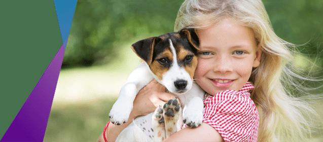 blonde girl holding puppy